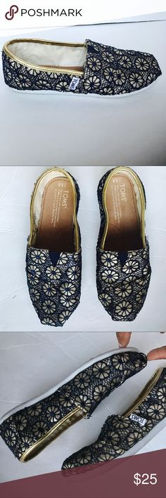 "TOMS Girls floral Navy & Gold Embroidered Slip-Ons These TOMS Girls glitter gold navy blue floral embroidered classic shoes are previously owned in Very Good Condition with signs of wear on shoe soles.  DETAILS: The shoes that started it all. Alpargatas with a fun print. 	•	Navy Embroidered Floral Pattern with Gold Glitter 	•	Classic Alpargata design 	•	Vegan 	•	For ages 5-9 	•	Elastic ""v"" for easy on/off 	•	Cotton twill antimicrobial sockliner 	•	Rubber outsole for traction Toms Shoes…"