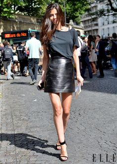 oh lord... if only I could rock this look... the black t-shirt tones down the leather skirt beautifully. Now I just need that gorgeous hair and those long legs!