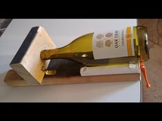 Learn how to easily cut off the bottom of glass bottles with a cheap, homemade bottle cutter. See my tutorial on how to make this homemade bottle cutter for . Cutting Glass Bottles, Empty Glass Bottles, Wine Bottle Candles, Bottle Cutting, Wine Bottle Art, Diy Bottle, Wine Bottle Crafts, Cut Bottles, Plastic Bottle Cutter
