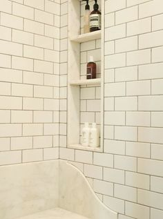 subway tile and marble lined shower niche with marble shelf Shower Seat, Shower Niche, Master Shower, Bath Shower, Master Bathroom, Bathroom Niche, Shower Walls, Glass Shower, Bathroom Vanities