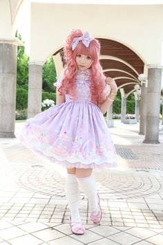 "how adorable.  ""Lolita"" fashion is the name for clothes worn by Japanese teenage girls, making them look like elaborately dressed little girl dolls.  This girl almost doesn't look real!"