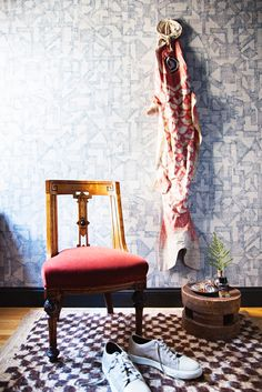 Geometric wallpaper and vintage chair