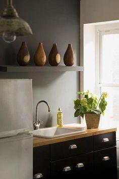 black cabinets, white appliances