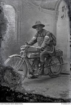 Portrait of an unidentified signaller on a despatch motorcycle with a gas respirator bag worn on his chest.   From the Thuillier collection of glass plate negatives. Taken by Louis and Antoinette Thuillier in Vignacourt, France during the period 1916 to 1918.