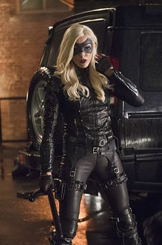 I'm Laurel Lance my sister is Sara. I have a phonographic memory. I am an assassin. My powers are: teleportation, future seer, and I voice manipulation.