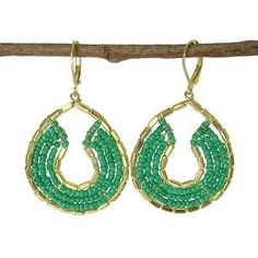 Byzantine Earrings in Teal and Gold - WorldFinds. Three rows of opaque seed beads arc around a frame of metallic barrel beads in these classic earrings that measure inches in diameter and hang from hinged lever-back hooks.