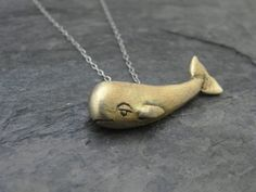 "A highly improbable sperm whale necklace for the ""Hitchhiker's Guide"" fan in your life."