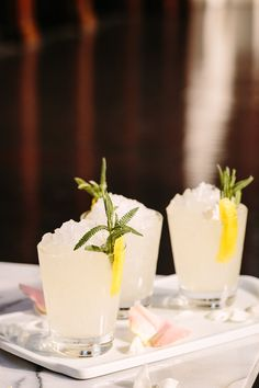 Mix gin, lavender infused simple syrup, lemon, crushed ice, lemon peel and lavender greens.