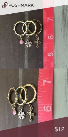 ADORABLE SET OF 3 STACKABLE RINGS WITH CHARMS  VERY PRETTY, SET OF 3 STACKABLE RINGS WITH CHARMS! WEAR ALL THREE, JUST ONE, OR ALL 3 ON DIFFERENT FINGERS! SIZE: 6!  Jewelry Necklaces
