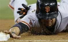San Francisco Giants' Gregor Blanco dives back safely to first during the seventh inning against the San Diego Padres in a baseball game Thursday, July 11, 2013, in San Diego. (AP Photo/Gregory Bull)