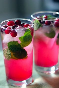 Christmas mojitos (rum, soda, mint, sugar, cranberry juice, cranberries)