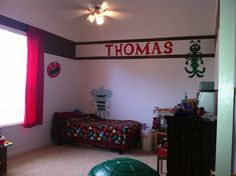 Boys monster room, red and brown, 15 ft ceilings so border is not at top of the room. Monsters painted on the wall from his fleece blanket on bed.
