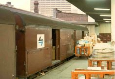 Parcels & mail being loaded onto a country train. Metro Rail, Rail Transport, Electric Train, Central Station, Historical Images, Old Buildings, Sydney Australia, Train Station, Nice Things