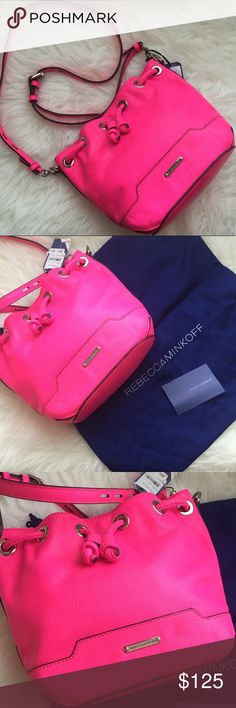 """NWT Rebecca Minkoff Fiona Bucket Bag Electric Pink Brand new with tags Rebecca Minkoff """"Fiona Bucket Bag"""" in Electric Pink. Some damage to tag as pictured, this was purchased as a store display item because I really wanted it and the display was the only one left. Everything else is perfect about this bag. Comes with care card and dustbag as pictured. Approximate measurements: 8.5"""" L, 4"""" W, 8"""" H, 22"""" adjustable crossbody/shoulder strap. T4 Rebecca Minkoff Bags Crossbody Bags"""