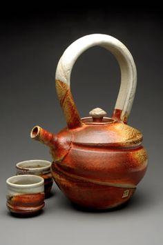 ceramic tea set. use of asymmetry