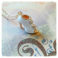 Fashion Heel Necklace. Shoe Charm NWOT Pretty little Charm necklace with a fashion boot embellished with rhinestones and white enamel. Jewelry Necklaces