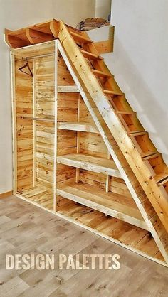 Just look at this adorable wood pallet installation. It has escalated and completely changed the look of this certain room with its glowing appearance. This wide spread wooden cabinet along with the stairs connecting to the upper portion is a great idea that would help the users in dual manners.