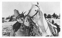 Tex Ritter and White Flash.Tex had a great singing voice,along with a great horse!!