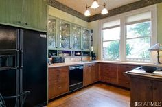 it's ok to have brown cupboards...maybe we should keep ours? (or maybe not)