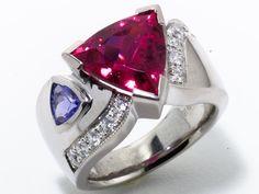 4.11 Carat Trillion Cut Pink Tourmaline .48 Carat Trillion Cut Tanzanite 11  full-cut round brilliant diamonds totaling approximately 1/3 carat