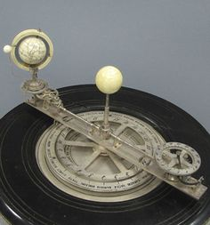 The most fascinating piece of all is perhaps a French ivory and silver brass orrery timepiece (an apparatus for representing the positions, motions, and phases of the planets, satellites, etc., in the solar system) which belonged to an English ambassador to France
