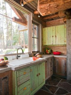 Rustic kitchen, distressed cabinet, slate floor, large window with lots of light, beautiful! via: This is not a Nature blog