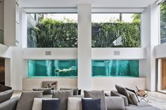 The swimming pool inside 'Panorama' — a house designed by Brazilian studio Fernanda Marques Arquitetos Associados — is a giant human aquarium that is the highlight of the home.
