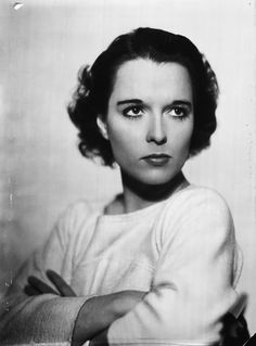 LOUISE BROOKS. shes so beautiful without the slick hairdo and all the makeup she really is beautiful. No she's wearing makeup but it's not excessive.