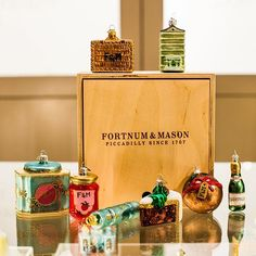 Fortnum and Mason offer high-quality Christmas hampers, Christmas gifts, and Christmas food. Visit our Piccadilly store or shop online today. Food Themes, Party Themes, Christmas Tree Ornaments, Christmas Gifts, Luxury Hampers, Christmas Hamper, Fortnum And Mason, Christmas Pudding, Tea Caddy