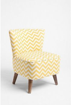 You can add a fun touch of color and texture to any room with this chevron stripe chair! Add a solid throw pillow to tone it down or tie it in.