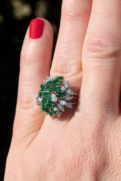 cluster style ring is accented with fourteen round mixed cut natural emeralds set into eighteen karat yellow gold three-prong heads, three pear brilliant cut diamonds set into platinum three-prong heads, four marquise brilli Diamond Cluster Ring, Emerald Diamond, Emerald Green, Diamond Cuts, Designer Jewelry, Jewelry Design, Daughters, To My Daughter, Green Rings