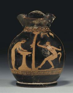 A LUCANIAN RED-FIGURED OINOCHOE - CIRCA LATE 5TH-EARLY 4TH CENTURY B.C.