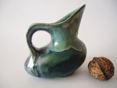 Small pitcher. Neolithic pot Ancient replica  askos modeled