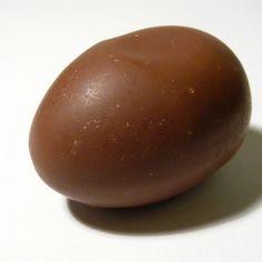 A chocolate egg Plum, Eggs, Chocolate, Fruit, Reading, Food, Essen, Egg, Chocolates