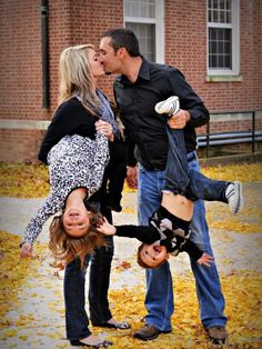 Well, Maybe we wont be kissing in a picture like this but kids would have fun getting hung upside down;) 24 Absolutely Creative Family Portraits You Can Shoot