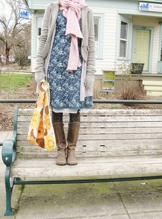 I love me some crazy cat lady style. tights and boots and a stretched out cardi.