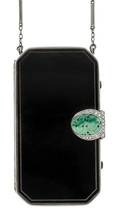 Art Deco Silver, Platinum, Black Enamel, Carved Jade and Diamond Vanity with Carrying Chain. 2 makeup compartments, lipstick case & mirror, with maker's mark & French assay mark, c. 1920, silver-gilt interior. #ArtDeco #vanity  www.vintageclothin.com