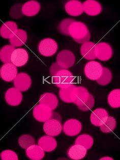 defocused image of pink halloween lights. - Defocused image of pink Halloween lights over black background.