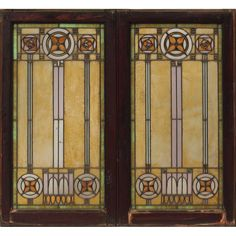 """Prairie School Pair of Leaded Glass Light Screen Windows. Amber, Clear & Coloured Glass with Lead Came in Wood Window Frames. America. Circa 1900. Each Panel: 46"""" x 25""""."""