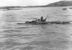Kayak, one man paddling the other lying down on top behind the cockpit. 1911-12. Photographer unknown. MacMillan collection, Bowdoin College, Brunswick, Maine, USA. -- http://www.kayakers.nf.ca/sea_kayaking/labrador_kayak/images/macmillan22.jpg