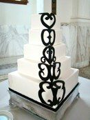 A clean scrolling design on this cake creates a dramatic appearance.