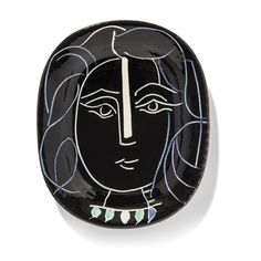 Pablo Picasso (1881-1973)Visage de femme (A.R. 220)stamped 'Madoura Plein Feu / Edition Picasso' (underneath)white earthenware ceramic plate, partially engraved with coloured engobe and glazeLength: 14 ⅝ in. (37 cm.)Conceived in 1953 and executed in an edition of 400