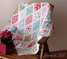 If you're looking for pretty baby quilt ideas for a new little girl in your life, the Divine Diamonds Baby Quilt is a sweet and elegant baby quilt pattern that will look lovely in a feminine nursery. Simple white sashing separates diamonds of floral