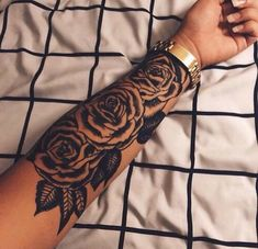 Black and white rose arm tattoo