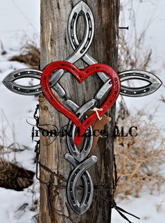 Shiny Horseshoe cross with painted heart in the by Ironnlace1