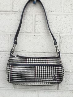 Tweed/Herringbone purse with zipper closure.