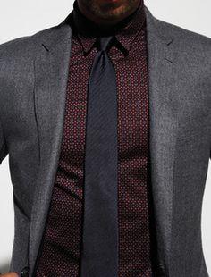 dark grey suit, burgundy shirt, black tie