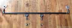 DIY Rolling Door Hardware using Plumbing Pipe - Jenna Burger Barn Door Closet, Diy Barn Door Hardware, Sliding Barn Door Hardware, Door Latches, Diy Sliding Barn Door, Sliding Doors, Plumbing Pipe, Diy Furniture Projects, Pipe Furniture