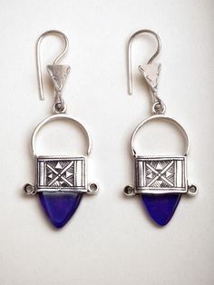 The traditional Tuareg silversmiths of the Koumama family collective from Agadez Niger craft beautiful jewelry like these Ingal earrings. To begin, pure 99.9% silver is melted, its malleable form and