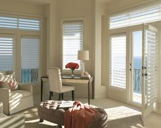 Warm white decor with a whisper of elegance. ♦ Hunter Douglas window treatments - Pirouette ® window shadings  #LivingRoom